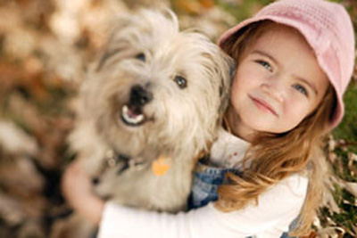 ca. 2003 --- Little Girl with Pet Terrier --- Image by © Edward Bock/CORBIS